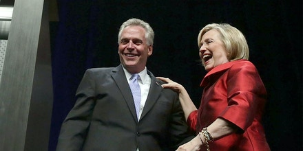 FAIRFAX, VA - JUNE 26:  Democratic U.S. presidential hopeful and former U.S. Secretary of the State Hillary Clinton and Virginia Governor Terry McAuliffe share a moment during the Democratic Party of Virginia Jefferson-Jackson dinner June 26, 2015 at George Mason University's Patriot Center in Fairfax, Virginia. It's the first visit for Clinton since she announced her candidacy.  (Photo by Alex Wong/Getty Images)