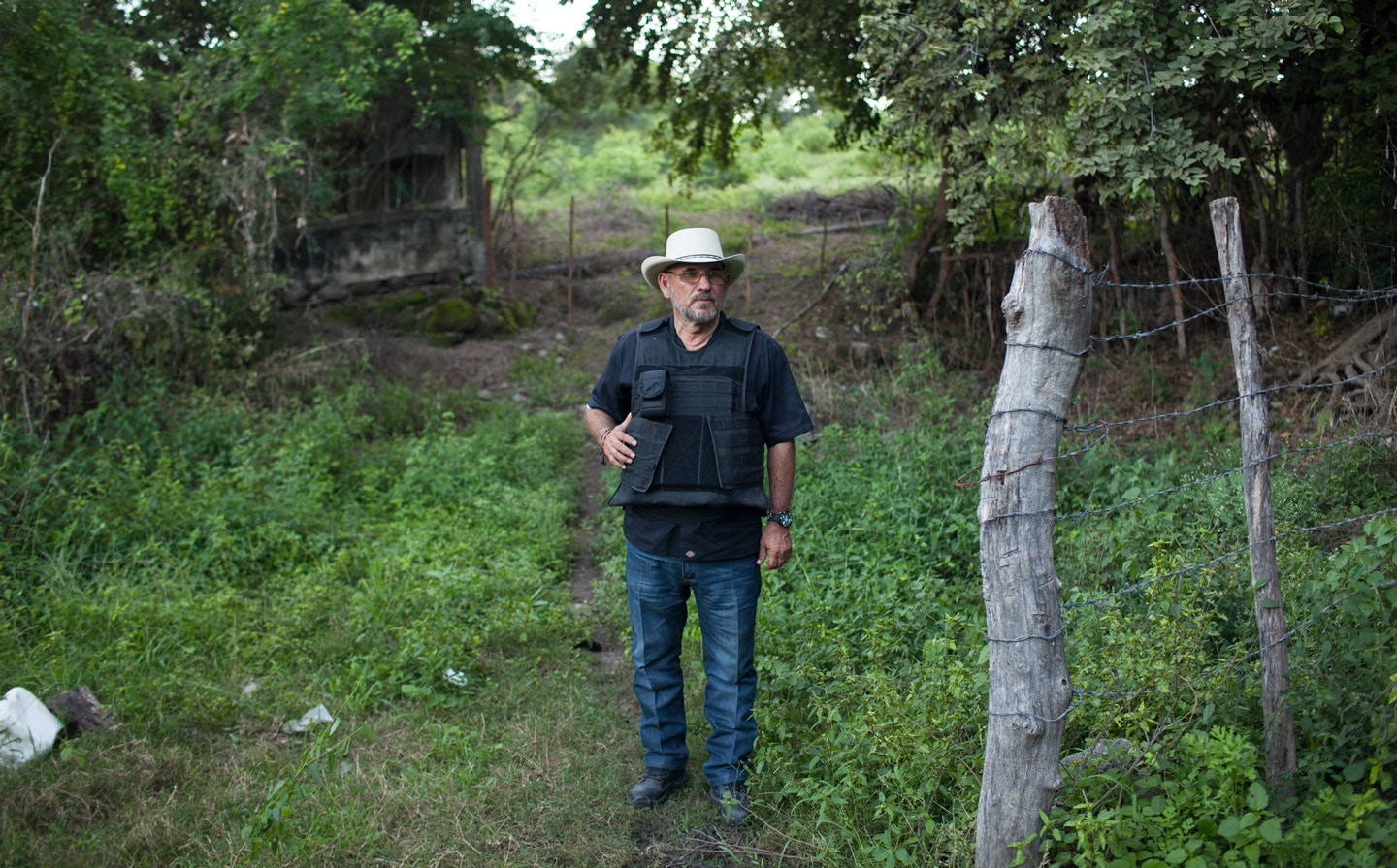 "Hipolito Mora at his families lime ranch in La Ruana, Michoacán, Mexico, Tuesday, December 15, 2015. Hipolito Mora was one of the original founder of the autodefensa movement, which saw vigilantes spread across the state of Michoacán and drive out the cartel group the 'Knights of Templar'. Since the uprising began in 2013, other criminal groups have filled the space of the previous cartel and many look at the autodefensa movement as a failure. Mora has had many challenges over the last three years, including being sent to jail twice and having his son killed in a shootout Dec. 16, 2014 during a shootout with a rival group. </p> <p>This ranch is a very important place for Mora. ""This is where I expect to die"" said Mora, motioning to the hills surrounding the ranch, which would make for a great spot for a shooter to hide. ""My son and I had plans to build up the house and make this out place, it was out dream, but that was before.""<br /> (Brett Gundlock/Boreal Collective)"