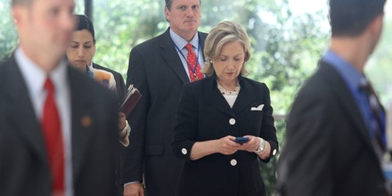 US secretary of state Hillary Clinton (C) looks at her mobile phone after attending a Russia - US meeting on the sidelines of the 43rd annual Association of South East Asian Nations (ASEAN) Ministering Meeting in Hanoi on July 23, 2010. Asia-Pacific's biggest security dialogue convenes in Vietnam with ructions over North Korea and friction between the United States and China likely to dominate proceedings. AFP PHOTO / POOL / Na Son Nguyen (Photo credit should read Na Son Nguyen/AFP/Getty Images)
