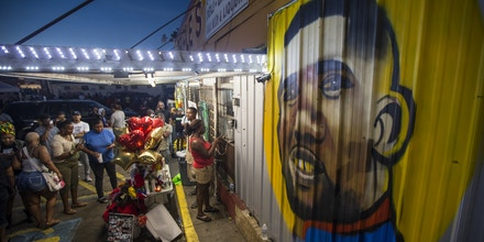 BATON ROUGE, LA -JULY 06:  protesters gather in front of a mural painted on the wall of the convenience store where Alton Sterling was shot and killed, July 6, 2016 in Baton Rouge, Louisiana.  Sterling was shot by a police officer in front of the Triple S Food Mart in Baton Rouge on Tuesday, July 5, leading the Department of Justice to open a civil rights investigation. (Photo by Mark Wallheiser/Getty Images)