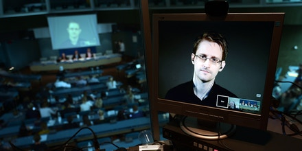 NSA former intelligence contractor Edward Snowden is seen via live  video link from Russia on a computer screen during a parliamentary hearing on the subject of