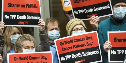 Cancer patients and survivors, health professionals and others protest the Trans-Pacific Partnership (TPP) trade deal outside of PhRMA, the Pharmaceutical Research and Manufacturers of America, in Washington, DC, February 4, 2016.Cancer patients and survivors, health professionals and others demonstrated outside the trade group's offices against the TPP, which they say will prevent access to life-saving generic medicines and increase drug costs. / AFP / Saul Loeb (Photo credit should read SAUL LOEB/AFP/Getty Images)