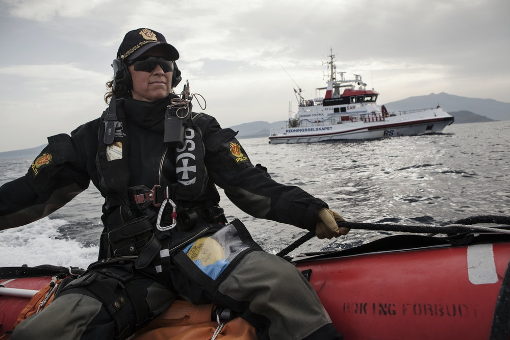 "AT SEA - FEBRUARY 29:   Norwegian Redningsselskapet rescue boat ""Peter Henry Von Koss"" conducts a Frontex sea patrol off the northern shores of Lesbos island (in background)  on February 29, 2016. Norwegian police officer Anne Marie Bruu rides on a launch boat during the patrol. Lesbos, the Greek vacation island in the Aegean Sea between Turkey and Greece, faces massive refugee flows from the Middle East countries. (Photo by Etienne De Malglaive/Getty Images)"