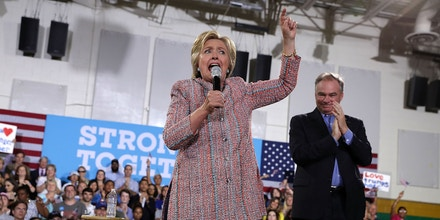 ANNANDALE, VA - JULY 14:  Democratic presidential candidate Hillary Clinton (L)   speaks as U.S. Sen. Tim Kaine (D-VA) (R) listens during a campaign event at Ernst Community Cultural Center at Northern Virginia Community College July 14, 2016 in Annandale, Virginia. Hillary Clinton continued to campaign for the general election in November.  (Photo by Alex Wong/Getty Images)