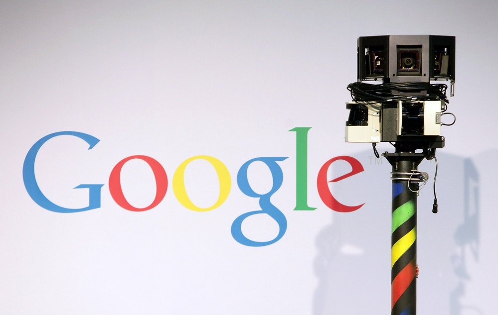 HANNOVER, GERMANY - MARCH 03:  The camera of a German Google Street View car looms over the car next to the Google logo at the Google stand at the CeBIT Technology Fair on March 3, 2010 in Hannover, Germany. Google's Street View project has raised controversy from people across Europe worried about infringement of their privacy. CeBIT will be open to the public from March 2 through March 6.  (Photo by Sean Gallup/Getty Images)