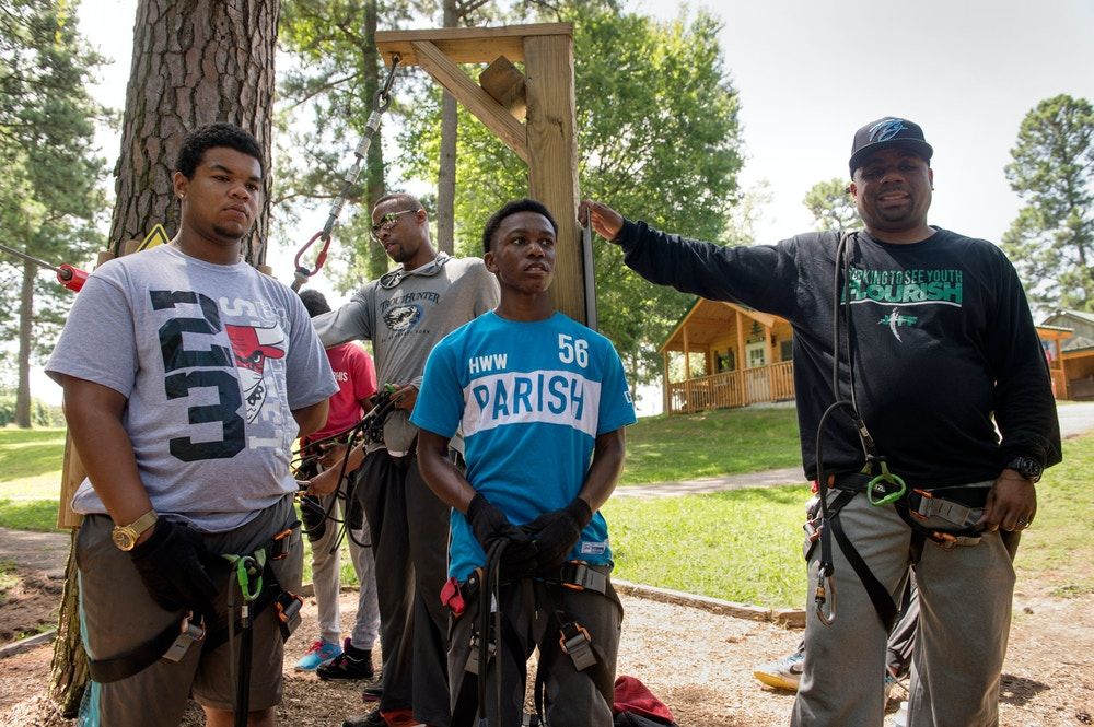 July 12, 2016 - JIFF program participants (from left) Adarius Boltze, 16, Devion Thomas, 14, case mentor Grady Turner, Cordarius Lane, 15, and case mentor Troy Dotson prepare for a treetop rope course and zip line activity in Memphis. (Photo by Brandon Dill)