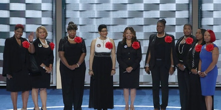 PHILADELPHIA, PA - JULY 26:  Mothers of the Movement (L-R) Maria Hamilton, mother of Dontre Hamilton; Annette Nance-Holt, mother of Blair Holt; Gwen Carr, mother of Eric Garner; Geneva Reed-Veal, mother of Sandra Bland; Lucia McBath, mother of Jordan Davis; Sybrina Fulton, mother of Trayvon Martin; and Cleopatra Pendleton-Cowley, mother of Hadiya Pendleton; Lezley McSpadden, Mother of Mike Brown and Wanda Johnson, mother of Oscar Grant; and Lezley McSpadden, Mother of Mike Brown stand on stage prior to delivering remarks on the second day of the Democratic National Convention at the Wells Fargo Center, July 26, 2016 in Philadelphia, Pennsylvania. Democratic presidential candidate Hillary Clinton received the number of votes needed to secure the party's nomination. An estimated 50,000 people are expected in Philadelphia, including hundreds of protesters and members of the media. The four-day Democratic National Convention kicked off July 25.  (Photo by Alex Wong/Getty Images)