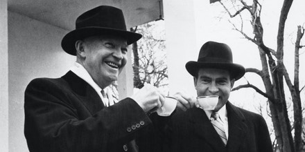 President Eisenhower (left) and his Vice-President Richard Nixon, drinking tea at the President's second Inauguration, Washington DC, January 1957. (Photo by Keystone/Hulton Archive/Getty Images)