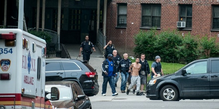 Assignment No. 30159278A   ---  30159278A      ---    Orig. Caption: JUNE 4, 2014-NEW YORK, NY-USA: Members of the NYPD Gang Division raid the Manhattanville Houses and the Grant Houses early Wednesday morning holding warrants for more than 100 gang members wanted in connection for murder, and other gang related offenses.(Robert Stolarik for the New York Times)            NYTCREDIT: Robert Stolarik for The New York Times