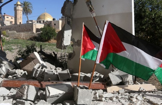Palestinian flags are seen placed on the rubble of a house belonging to a Palestinian man who carried out a knife attack in Tel Aviv on March 8 in which an American tourist was killed, after it was demolished by Israeli security forces in the village of Haja, in the Israeli-occupied West Bank on June 21, 2016.</p><br /><br /> <p>An Israeli spokeswoman said Palestinian Bashar Madhala carried out the March 8 seafront knife attacks which killed 29-year-old Texan Taylor Allen Force and wounded at least 10 Israelis as US Vice President Joe Biden arrived for a visit.</p><br /><br /> <p> / AFP / JAAFAR ASHTIYEH        (Photo credit should read JAAFAR ASHTIYEH/AFP/Getty Images)