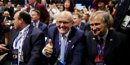 CLEVELAND, OH - JULY 19: Former New York City Mayor Rudy Giuliani gives a thumbs up as Ed Cox, NY Republican party chairman looks on during the second day of the Republican National Convention on July 19, 2016 at the Quicken Loans Arena in Cleveland, Ohio. Republican presidential candidate Donald Trump received the number of votes needed to secure the party's nomination. An estimated 50,000 people are expected in Cleveland, including hundreds of protesters and members of the media. The four-day Republican National Convention kicked off on July 18.  (Photo by Chip Somodevilla/Getty Images)
