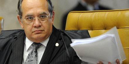 Brazilian Supreme Court Minister Gilmar Mendes during the session on the case of Italian Cesare Battisti in Brasilia, on June 8, 2011.Thirty years after fleeing Italy, former far-left militant Cesare Battisti will likely find out Wednesday whether he will be extradited to his native country on murder charges or remain in Brazil, perhaps as a free man. Italy wants Brazil to extradite Battisti, convicted in an Italian court in 1993 for the murders of four people in the 1970s when he was a member of the radical Armed Proletarians for Communism (PAC) group. AFP PHOTO/Evaristo SA (Photo credit should read EVARISTO SA/AFP/Getty Images)