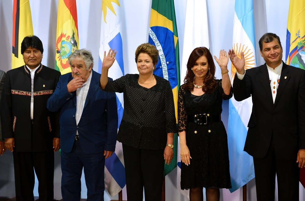 (L to R) Presidents from Bolivia, Evo Morales, Uruguay, Jose Mujica, Brazil, Dilma Rousseff, Argentinian Cristina Fernandez de Kirchner and Ecuador, Rafael Correa, pose for the official picture of the Summit of Heads of State of Mercosur and Associated States, at Itamaraty Palace, Bras?lia on December 7, 2012. AFP PHOTO/Pedro LADEIRA        (Photo credit should read PEDRO LADEIRA/AFP/Getty Images)