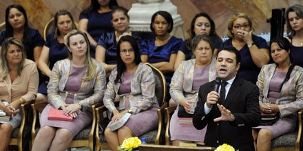 TO GO WITH AFP STORYEvangelical minister and president of the House of Deputies' commission of human rights and minorities, Marco Feliciano, prays during a gathering of the Assembly of God church, in Goiania, Goias State, Brazil, on May 19, 2013. Feliciano's election is seen as a sign of the growing influence of evangelicals in Congress, where they have 67 deputies ot of a total 513, and in Brazilian politics in general. Evangelicals count 565 million adherents and represent more than one-fourth of the world's Christians, according to French researcher Sebastien Fath. AFP PHOTO / Evaristo SA (Photo credit should read EVARISTO SA/AFP/Getty Images)