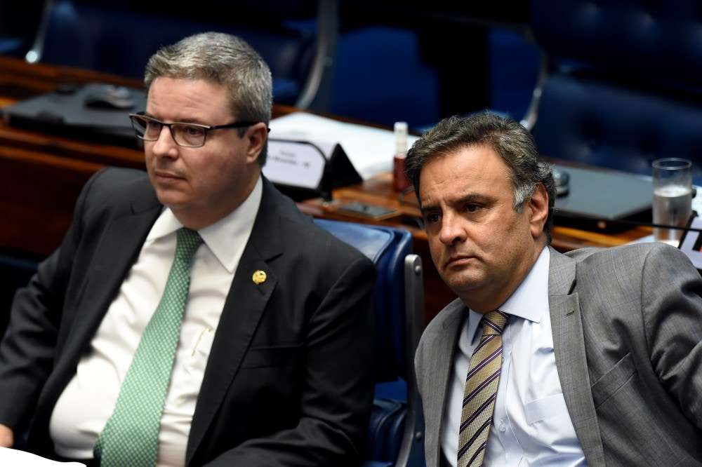 Senator Aecio Neves (R), who heads the PSDB opposition party, sits next to senator Antonio Anastasia, also from the PSDB, during a senate's session to form a committee that will consider whether to impeach President Dilma Rousseff, in Brasilia, on April 25, 2016.<br /><br /><br /><br /><br /><br /><br /> Brazil's Senate met Monday to form a committee that will consider whether to impeach Rousseff, who has accused her opponents of mounting a constitutional coup. She is accused of illegal government accounting maneuvers, but says she has not committed an impeachment-worthy crime. The Senate committee -- comprising 21 of the 81 senators -- was to debate Rousseff's fate for up to 10 working days before making a recommendation to the full upper house.<br /><br /><br /><br /><br /><br /><br />  / AFP / EVARISTO SA        (Photo credit should read EVARISTO SA/AFP/Getty Images)