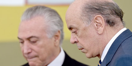 Brazilian acting President Michel Temer (L) and his Foreign Minister Jose Serra attend a ceremony of the presentation of credentials of Ambassadors at Planalto Palace in Brasilia on May 25, 2016. / AFP / EVARISTO SA        (Photo credit should read EVARISTO SA/AFP/Getty Images)