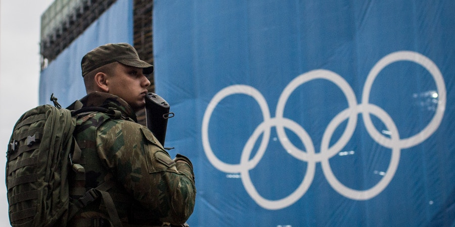 RIO DE JANEIRO, BRAZIL - AUGUST 08: A soldier keeps watch outside the Olympic beach volley ball venue at Copacabana Beach on August 8, 2016 in Rio de Janeiro, Brazil. Olympic team members, officials and other visitors have reported a rash of robberies in recent days in spite of a heavy police presence near Olympic venue sites.  (Photo by Chris McGrath/Getty Images)