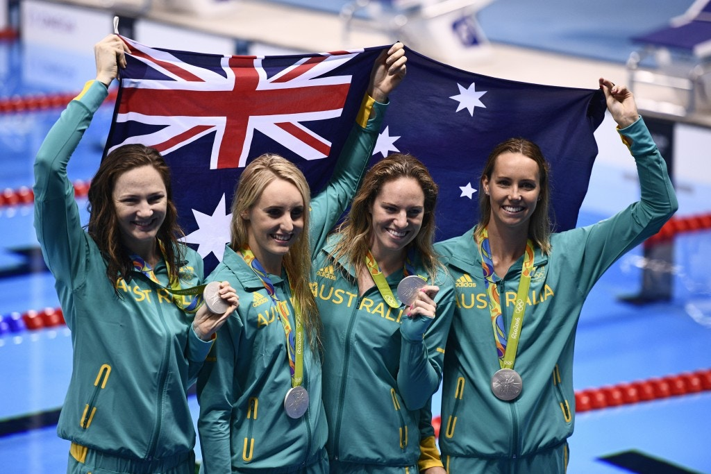Australia's silver medallist team Emily Seebohm, Taylor McKeown, Emma McKeon, Cate Campbell pose during the podium ceremony of the Women's swimming 4 x 100m Medley Relay Final at the Rio 2016 Olympic Games at the Olympic Aquatics Stadium in Rio de Janeiro on August 13, 2016.   / AFP / Martin BUREAU        (Photo credit should read MARTIN BUREAU/AFP/Getty Images)