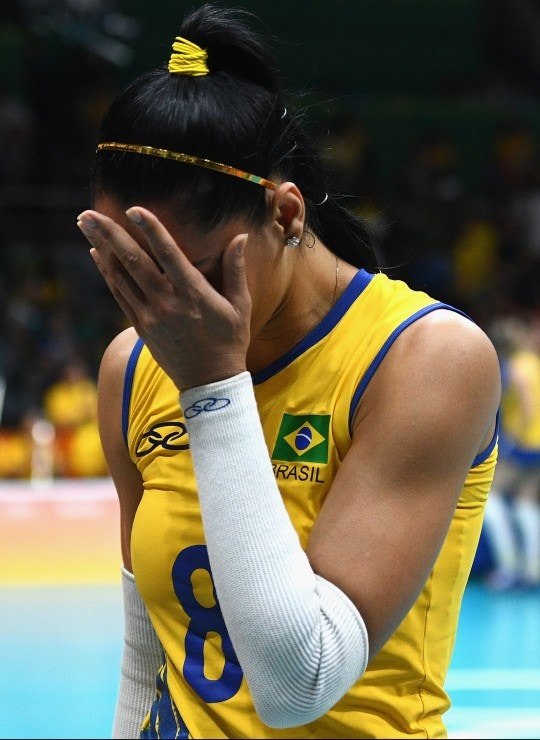 RIO DE JANEIRO, BRAZIL - AUGUST 17:  Jaqueline de Carvalho Endres of Brazil cries after being defeated by China during the Women's Quarterfinal match between China and Brazil on day 11 of the Rio 2106 Olympic Games at the Maracanazinho on August 17, 2016 in Rio de Janeiro, Brazil.  (Photo by David Ramos/Getty Images)