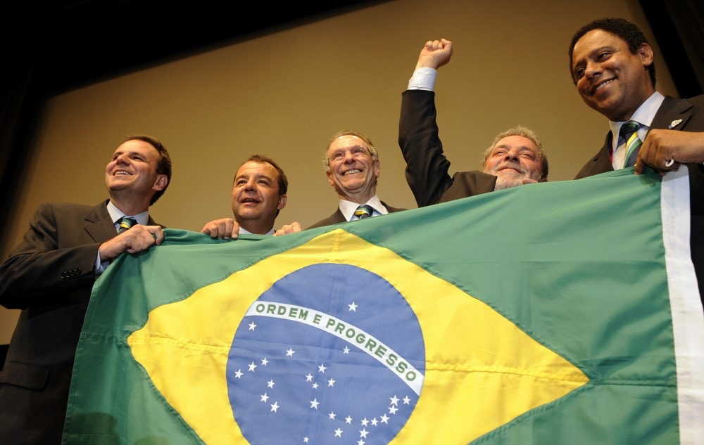 (L-R) Mayor of the city of Rio de Janeiro Eduardo Paes, Governor of the State of Rio de Janeiro Sergio Cabral, President of Rio 2016 Bid Committee Carlos Arthur Nuzman, Brazilian President Luiz Inacio Lula da Silva  and Brazilian Minister of sport Orlando Silva rejoice at the press conference after Rio won the right to host the 2016 Olympic games, on October 2, 2009 in Copenhagen. The International Olympic Committee (IOC) voted in Rio as the 2016 Summer Olympic city today after a final round battle in Copenhagen.  AFP PHOTO / FRANCK FIFE  (Photo credit should read FRANCK FIFE/AFP/Getty Images)