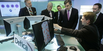 Britain's Prime Minister Gordon Brown, third right, his recently appointed Home Secretary Alan Johnson, second left, and Alan West, left, the Parliamentary Under-Secretary for Security and Counter-terrorism are seen during a visit to offices in London of the business and technology consultancy firm Detica, which is owned by BAE Systems, Thursday June 25, 2009.  The visit Thursday, was part of the launch of the British government's national security strategy update, and launch of the UK's first Cyber Security Strategy.  The cyber security strategy looks at reducing the risks posed by criminals and terrorists, ensuring citizens and business enjoy the full benefits of cyber space.  (AP Photo/Matt Dunham-WPA Pool)