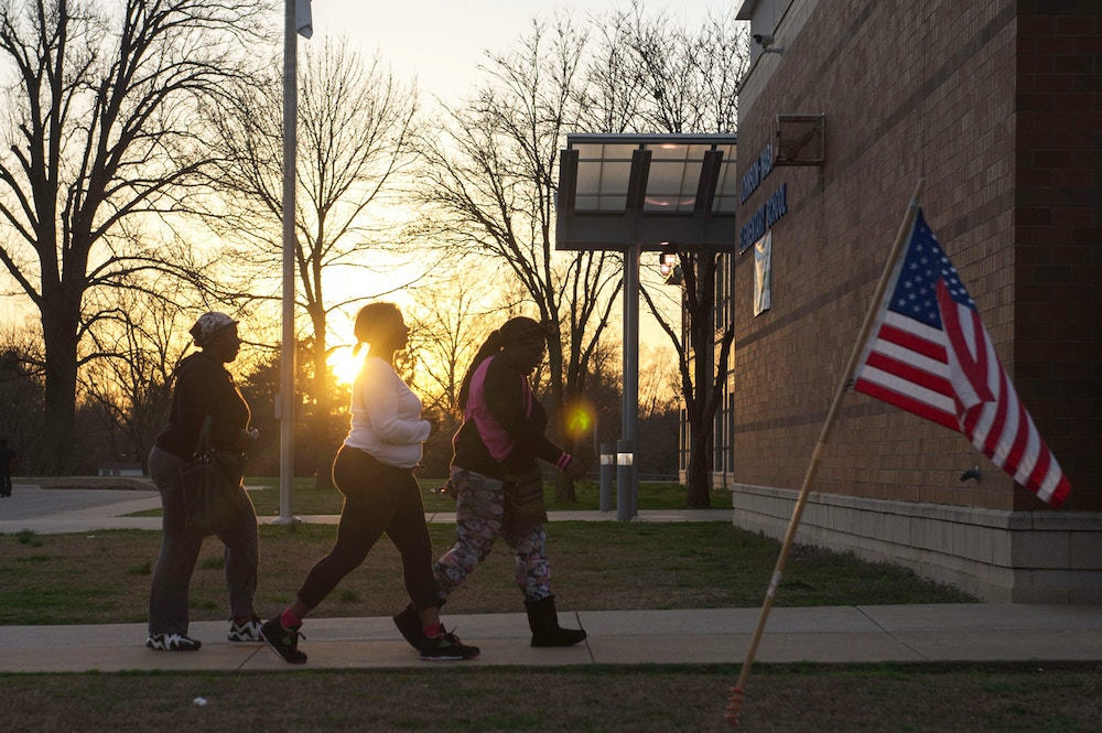 TOPSHOT - Last-minute voters arrive to cast their vote during Missouri primary voting at Johnson-Wabash Elementary School on March 15, 2016 in Ferguson, Missouri. / AFP / Michael B. Thomas        (Photo credit should read MICHAEL B. THOMAS/AFP/Getty Images)