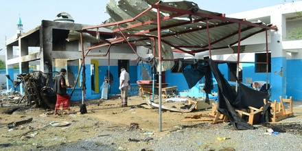 Yemeni workers clean at an hospital operated by the the Paris-based aid agency, Doctors Without Borders (MSF), on August 16, 2016 in Abs, in the rebel-held northern province of Hajja, a day after the hospital was allegedly hit by an air strike by the Saudi-led coalition, fighting against Iran-backed Shiite Huthi rebels.Eleven people were killed and more than nineteen others were wounded in the strike that hit the hospital in Abs, Doctors Without Borders (MSF) said. The Saudi-led coalition bombing rebels in Yemen launched a probe following international condemnation of the air raid. / AFP / STRINGER (Photo credit should read STRINGER/AFP/Getty Images)