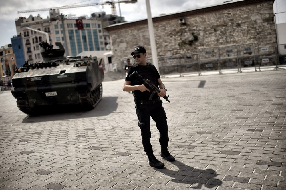 "A police officer stands next to an armoured vehicle that was used by soldiers during the coup attempt at Taksim square in Istanbul on July 17, 2016. Turkish President Recep Tayyip Erdogan vowed on July 17 to purge the ""virus"" within state bodies, during a speech at the funeral of victims killed during the coup bid he blames on his enemy Fethullah Gulen. / AFP / ARIS MESSINIS (Photo credit should read ARIS MESSINIS/AFP/Getty Images)"