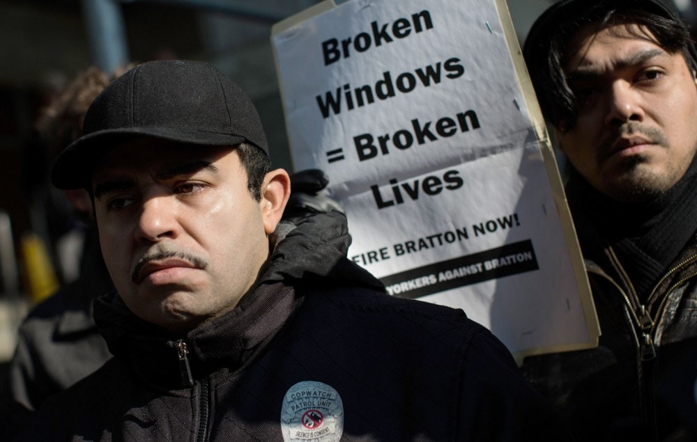 "NEW YORK, NY - JANUARY 16:  Activists protest the New York Police Department's ""Broken Windows"" policy outside the Patrolmen's Benevolent Association offices on January 16, 2015 in New York City. The protest comes at a time when police and community relations are strained after the death of Eric Garner, a black man who was killed by a police officer using a choke hold in July, 2014.  (Photo by Andrew Burton/Getty Images)"