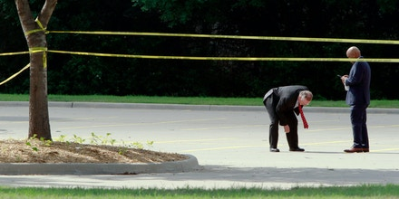GARLAND, TX - MAY 4:  Investigators work a crime scene before the removal a two bodies outside of the Curtis Culwell Center after a shooting occurred the day before May 04, 2015 in Garland, Texas. During the