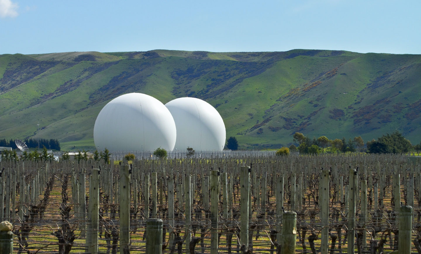 Domes covering satellite dishes in Waihopai Valley, near Blenheim, Marlborough, South Island, New Zealand.