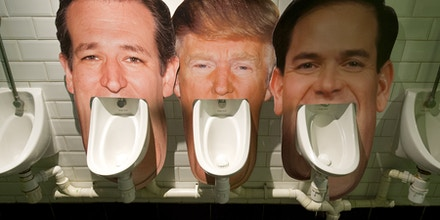 Cardboard cut outs of the faces of three candidates for the Republican nomination for the 2016 US Presidential election (L-R) Ted Cruz, Donald Trump and Marco Rubio, are seen set up on urinals in a pub in London on March 1, 2016 as part of an informal poll for customers to log which they dislike the most.Part of the satirical television show The Last Leg, customers at the pub are able to choose which urinal to use and then log their poll on a list on the wall afterwards. / AFP / JUSTIN TALLIS (Photo credit should read JUSTIN TALLIS/AFP/Getty Images)