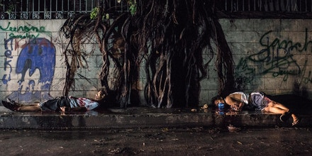 MANILA, PHILIPPINES - AUGUST 10:  (EDITOR'S NOTE: Image depicts death.) Two alleged drug suspects lie dead after an alleged shootout with police on August 10, 2016 in Manila, Philippines. The death toll from the Philippines' war on drugs initiated by President Rodrigo Duterte has spiked to nearly 1,800 since he took office in June, a figure much higher than the 900 deaths previously cited by officials. International human rights advocates have condemned the killings as out of control and  are calling on the government to end the nightly drug raids and investigate extrajudicial killings, although the president has lashed out at critics and threatened to withdraw from the United Nations. According to reports, investigations are still ongoing for 1,067 drug-related killings, reportedly carried out by vigilantes but it was unclear how many were directly related to the illegal drug trade.  (Photo by Dondi Tawatao/Getty Images)