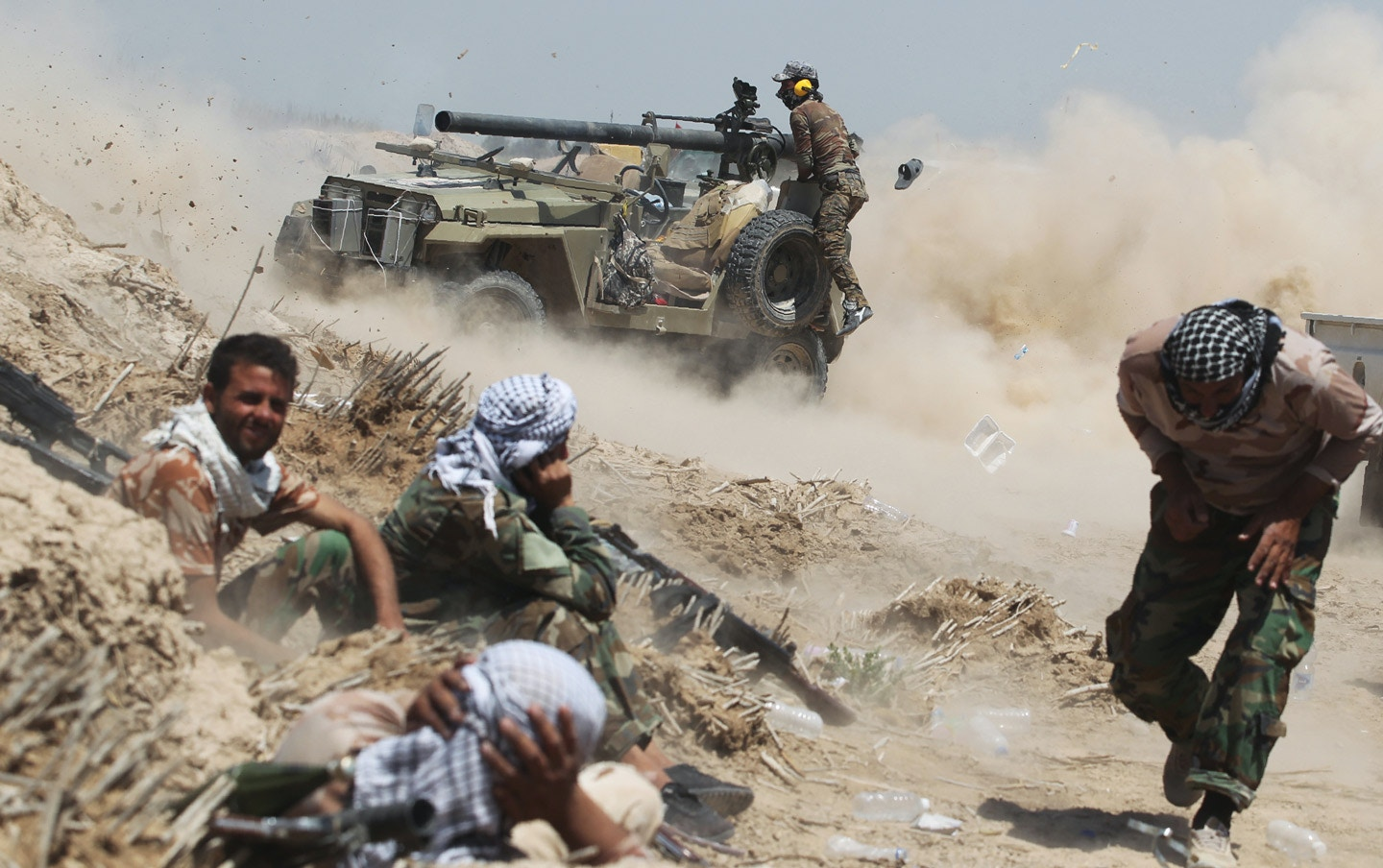 TOPSHOT - Iraqi pro-government forces fire an anti-tank cannon near al-Sejar village, north-east of Fallujah, on May 25, 2016, as they take part in a major assault to retake the city from the Islamic State (IS) group.<br /> Iraqi forces, consisting of special forces, soldiers, police, paramilitary-fighters and pro-government tribesmen, launched a major assault to retake Fallujah, the scene of deadly battles during the US occupation and one of the toughest targets yet in Baghdad's war on the Islamic State group. / AFP / AHMAD AL-RUBAYE        (Photo credit should read AHMAD AL-RUBAYE/AFP/Getty Images)