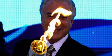 Brazilian acting President Michel Temer attends the reception ceremony of the Paralympic Torch at Planalto Palace in Brasilia, on August 25, 2016.The Rio 2016 Paralympic Games will be held in Brazil from September 7 through 18. / AFP / ANDRESSA ANHOLETE (Photo credit should read ANDRESSA ANHOLETE/AFP/Getty Images)
