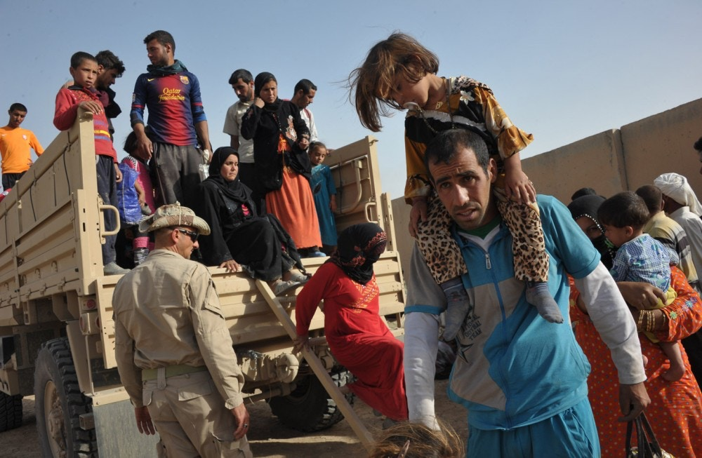 2862640 06/01/2016 A truck with Sunni Arab refugees fleeing ISIS-occupied areas to Kurds seen here near the city of Kirkuk, Iraq. Dmitriy Vinogradov/Sputnik via AP
