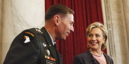 ** FILE ** Senate Armed Services Committee member, and Democratic Presidential hopeful, Sen. Hillary Rodham Clinton, D-N.Y., right, talks with Lt. Gen. David Petraeus on Capitol Hill in Washington in this Jan.. 23, 2007 file photo. Petraeus delivers his assessment of the Iraq war April 8, the next commander in chief will weigh in as well. Republican Sen. John McCain will get a chance to argue that last year's U.S. troop buildup has been a success and withdrawal would be a mistake. Clinton and Barack Obama will have an opportunity to ask why the United States is still fighting more than five years after the invasion.  (AP Photo/Dennis Cook, File)