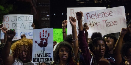 Protesters march in Charlotte, North Carolina, on September 23, 2016 following the shooting of Keith Lamont Scott by police three days earlier and subsequent unrest in the city.Hundreds of protesters were out again on Friday night calling for the release of the videos amid a greater presence of National Guard troops, but the atmosphere was calmer than during previous days. / AFP / NICHOLAS KAMM (Photo credit should read NICHOLAS KAMM/AFP/Getty Images)