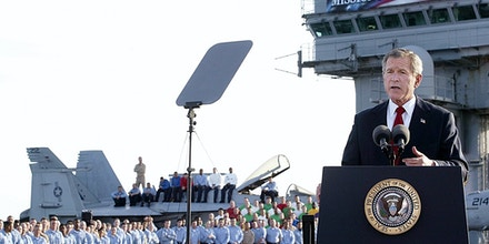 USS ABRAHAM LINCOLN, AT SEA: (FILES) -- A file photo taken 01 May 2003 shows US President George W. Bush addressing the nation aboard the nuclear aircraft carrier USS Abraham Lincoln as it sails for Naval Air Station North Island, San Diego, California. Four years after the US-led invasion of Iraq, commanders are in fact pouring 25,000 reinforcements into Baghdad to quell Sunni-Shiite fighting, the bloodiest element of the conflict and one which even the Pentagon admits now amounts to civil war.        AFP Photo / Stephen JAFFE (Photo credit should read STEPHEN JAFFE/AFP/Getty Images)