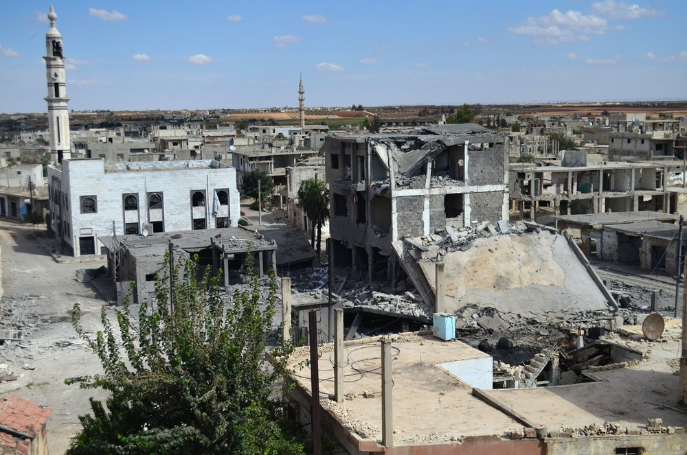 A picture taken on September 30, 2015 shows a general view of deserted streets and damaged buildings in the central Syrian town of Talbisseh in the Homs province. Russia confirmed on Septemer 30 that it carried out its first airstrike in Syria, near the city of Homs, marking the formal start of Moscow's military intervention in the 4.5-year-old conflict.  AFP PHOTO / MAHMOUD TAHA        (Photo credit should read MAHMOUD TAHA/AFP/Getty Images)