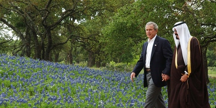 CRAWFORD, TX - APRIL 25:  U.S. President George W. Bush escorts Saudi Crown Prince Abdullah to his private office on his ranch April 25, 2005 in Crawford, Texas. The leaders are expected to talk about soaring global oil prices and prospects for peace in the Middle East.  (Photo by Rod Aydelotte-Pool/Getty Images)