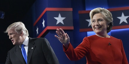 Republican presidential nominee Donald Trump and Democratic presidential nominee Hillary Clinton arrive on stage for the first presidential debate at Hofstra University in Hempstead, New York on September 26, 2016.