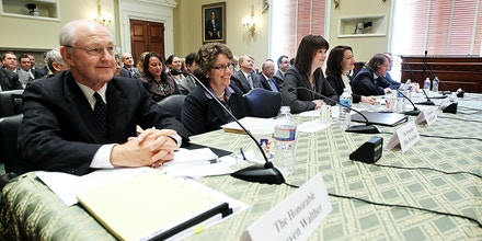WASHINGTON, DC - NOVEMBER 03:  Federal Election Commission (FEC) Chairman Cynthia Bauerly (3rd L), Vice Chairman Caroline Hunter (4th L), and Commissioners Donald McGahn II (5th L), Matthew Petersen (R), Steven Walther (L), and Ellen Weintraub (2nd L) testify during a hearing before the Elections Subcommittee of House Committee on House Administration November 3, 2011 on Capitol Hill in Washington, DC. The hearing was to focus on the polities, processes and procedures of the commission.  (Photo by Alex Wong/Getty Images)