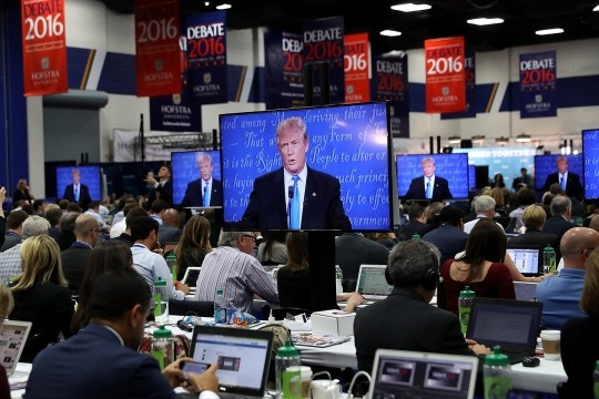 Republican presidential nominee Donald Trump appears on television monitors in the media center during the first presidential debate at Hofstra University on September 26, 2016 in Hempstead, New York.