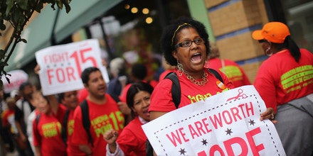 CHICAGO, IL - JULY 31: Whole Foods Market employees and union activists protest outside a Whole Foods Market store on July 31, 2013 in Chicago, Illinois. The protest was one of many scheduled against fast food and retail stores in several cities nationwide. The campaign, dubbed