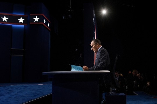 Moderator Lester Holt waits for the first US Presidential Debate at Hofstra University on September 26, 2016 in Hempstead, New York.