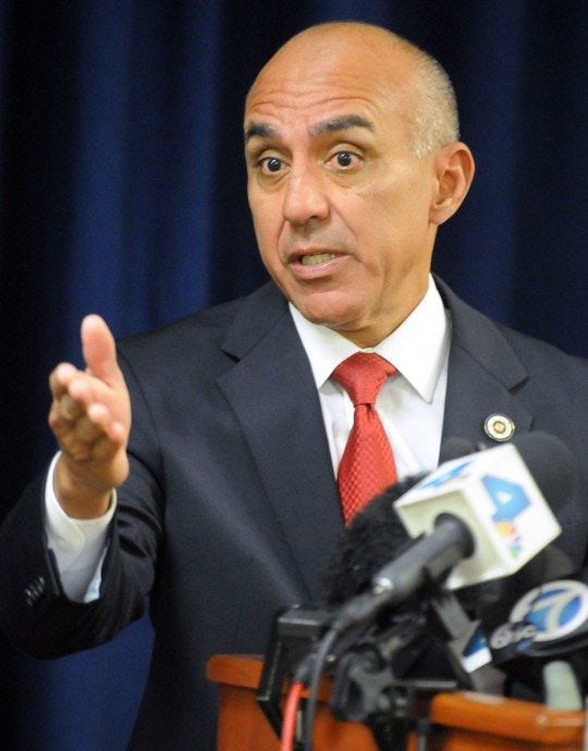 San Bernardino County District Attorney Mike Ramos, speaks during a press conference, Tuesday, Sept. 1, 2015, in San Bernardino, Calif., announcing that felony assault charges have been filed against San Bernardino County Sheriff's Deputies Nicholas Downey, Michael Phelps, and Charles Foster in the in the televised beating of Francis Pusok. A KNBC-TV helicopter news crew followed the chase as Frances Jared Pusok fled deputies on a stolen horse. The station then televised deputies repeatedly punching and kicking Pusok as he lay on the ground. Seven other deputies placed on administrative leave following the April pursuit in the inland desert were not charged. (James Quigg/The Victor Valley Daily Press via AP) MANDATORY CREDIT