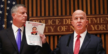 NEW YORK, NY - SEPTEMBER 19:  New York City police commissioner James O'Neill stands with Mayor Bill de Blasio as he holds up a picture of Ahmad Khan Rahami, the man believed to be responsible for the explosion in Manhattan on Saturday night and an earlier bombing in New Jersey, at a news conference at New York City on September 19, 2016 in New York City. Rahami was taken into custody on Monday afternoon following a gunfight where he was wounded by he police.  (Photo by Spencer Platt/Getty Images)