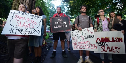 Protesters marched through the streets of Portland, Ore., on September 9, 2016, during a nationwide day of action against prison slavery on the 45th anniversary of the Attica Uprising, which saw the death of twenty-nine prisoners and ten hostages after inmates rioted for better conditions. (Photo by Alex Milan Tracy) *** Please Use Credit from Credit Field ***