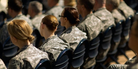 ARLINGTON, VA - MARCH 31:  Soldiers, officers and civilian employees attend the commencement ceremony for the U.S. Army's annual observance of Sexual Assault Awareness and Prevention Month in the Pentagon Center Courtyard March 31, 2015 in Arlington, Virginia. In conjunction with the national campaign against sexual assault, The Army announced this year's theme, 'Not in My Squad. Not in Our Army. We are Trusted Professionals,' during the ceremony.? According to the Pentagon, the initative 'is a grassroots approach meant to reinforce a climate of dignity and respect founded on good order and discipline.'  (Photo by Chip Somodevilla/Getty Images)